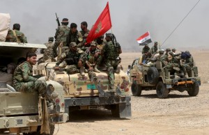 Iraq's Shi'ite paramilitaries and members of Iraqi security forces gather in Nibai, in Anbar province