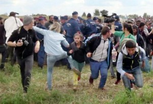Camerawoman and Migrants