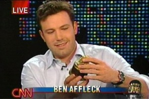 Ben Affleck admires his Razzie for Worst Actor for his performance in Gigli.