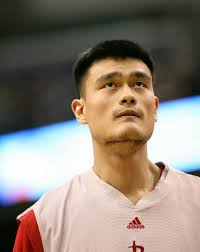 Yao watching his team at a game