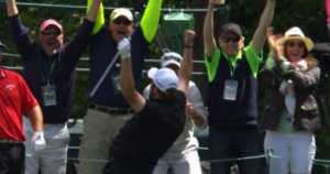 Irishman Shane Lowry celebrates after his hole in one at the iconic sixteenth hole