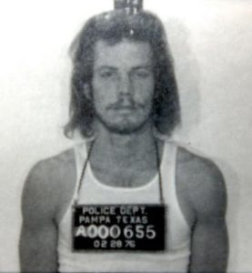 Chapman's arrest photo from the 70s, leaving us to wonder how long he's had that hair style
