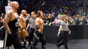 The Club. Gallows and Anderson, on the left, have been banned from ringside against AJ Styles's (right) match against John Cena