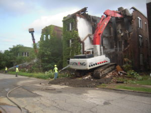 Apartment buildings and decrepit mansions alike have been condemned and destroyed en masse.