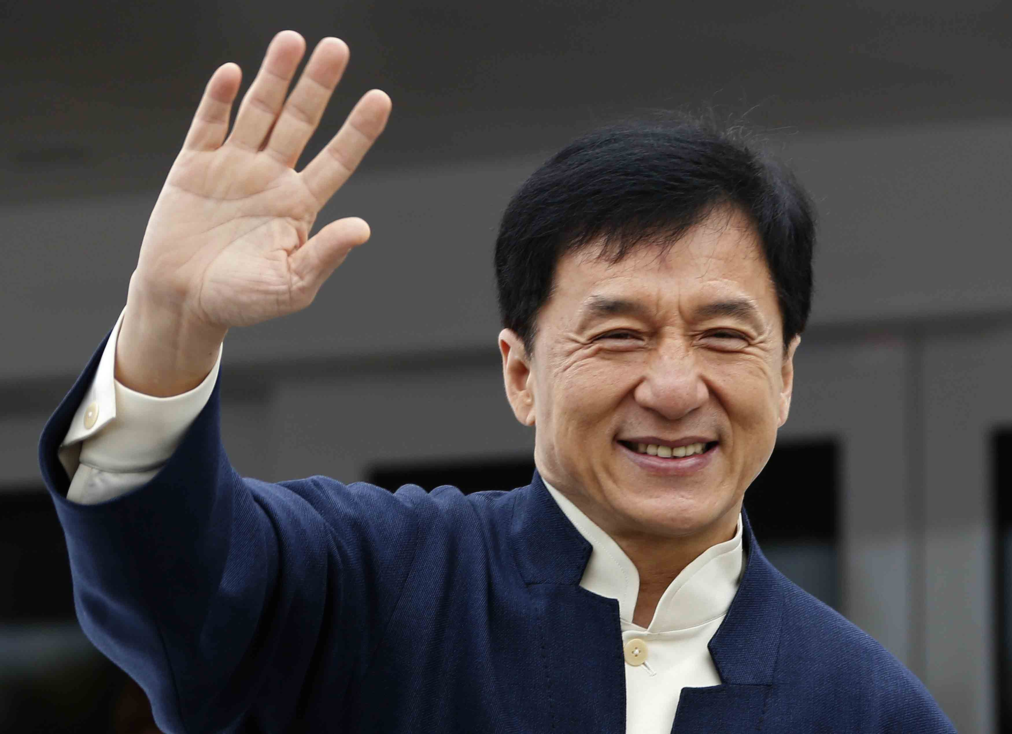 Actor Jackie Chan poses on a yatch during a photocall for the film 'Skiptrace' at the 66th Cannes Film Festival in Cannes May 16, 2013. REUTERS/Eric Gaillard (FRANCE - Tags: ENTERTAINMENT HEADSHOT) - RTXZOUW