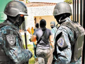 Hondurian police have had to become more militarized, as well as more clandestine to combat gang violence in recent years.