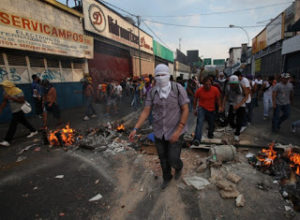 Riots and gang violence are all too common in San Pedro Sula.
