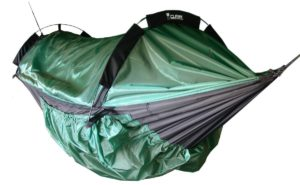 A large, green camping hammock with overhead poles