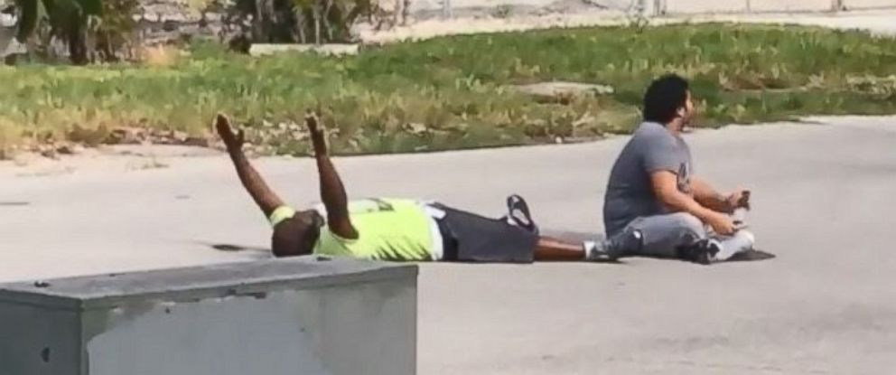 Cellphone video captured Charles Kinsey laying on the ground with his hands in the air.