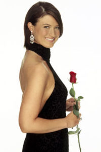 Phillips holding the iconic rose used in The Bachelor and Bachelorette