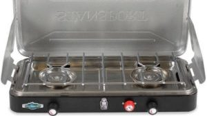 A grey and steel camping stove - camping stoves