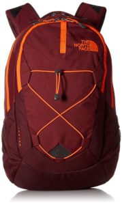 A brick red hiking backpack with orange details