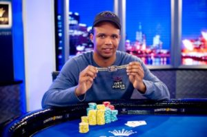 A rare photo of Phil Ivey smiling, showing off his WSOP bracelet for the 2013 Asia/Pacific Event #3