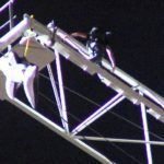 Steve-O climbing down from the enormous crane after his SeaWorld Protest