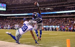 Nov 23, 2014; East Rutherford, NJ, USA; New York Giants wide receiver Odell Beckham (13) catches a touchdown pass over Dallas Cowboys cornerback Brandon Carr (39) during the second quarter at MetLife Stadium. Mandatory Credit: Adam Hunger-USA TODAY Sports
