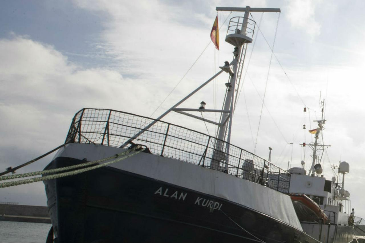 Aid ship with 64 migrants stuck at sea, denied safe harbor